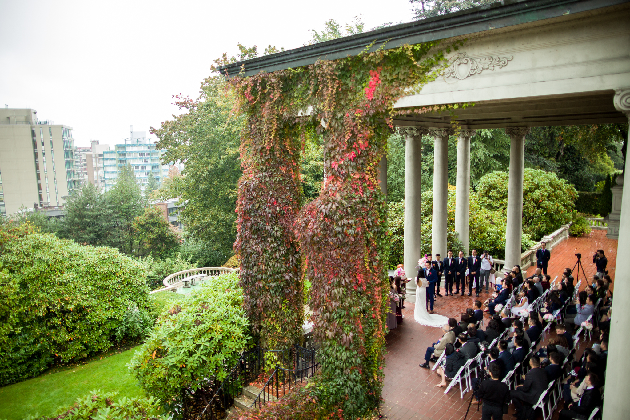 looking out the second floor window of Hycroft Manor while a beautiful wedding ceremony is happening under the canopy